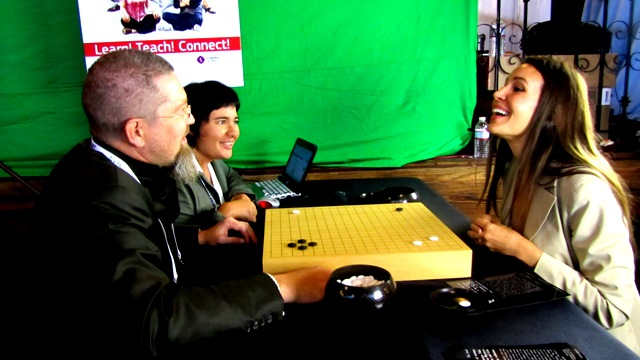 Igor Grishin, the head of Go&Strategy Dep., explains the Go game rules to Heather Harde, CEO of the TechCrunch-2011