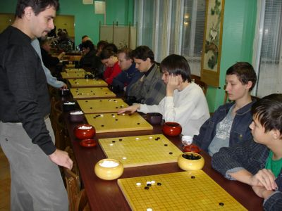 Mikhail Povalyaev 3d, the vice-president of The Go Federation, plays on 17 boards